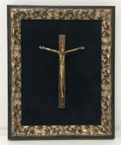 antique metal cucifix on black suede 640x480 1